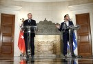 Greek Prime Minister Alexis Tsipras and Turkish President Tayyip Erdogan attend a press conference following their meeting at the Maximos Mansion in Athens, Greece December 7, 2017. REUTERS/Costas Baltas - RC14BE32B060
